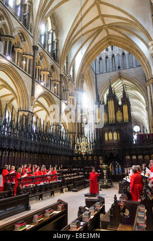 Choir practice inside choir stalls of Lincoln Cathedral in city of Lincolnshire England United Kingdom - Stock Photo
