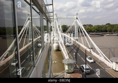 Albert Bridge cable stayed suspension bridge across River Thames linking Chelsea and Battersea built 1870-72 London - Stock Photo