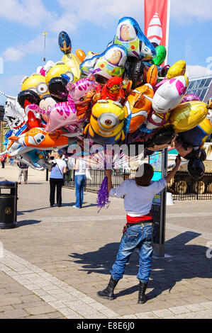 Woman sells helium balloons in Woolwich, London England United Kingdom UK - Stock Photo