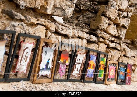 Horizontal close up of unusual artwork on sale along the battlements in Essaouira - Stock Photo