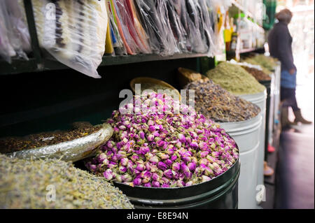 Horizontal close up of a shop full of herbs and spices in the souks of Marrakech.