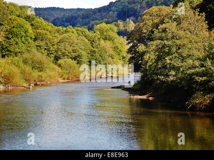 Stretch of the River Wye in Monmouthshire South Wales with a fly fisherman on the far bank - Stock Photo