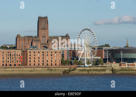 The Albert Dock Anglican Cathedral and Big Wheel in Liverpool UK - Stock Photo