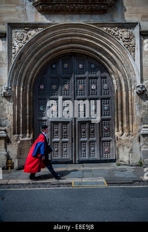 Oxford don wearing ceremonial gown walking past the Bodleian Library in Catte Street, Oxford after the Encaenia - Stock Photo