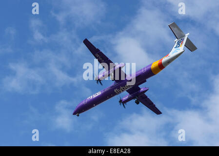 FlyBe De Havilland DHC 8 aircraft on the final approach to Manchester Airport UK - Stock Photo
