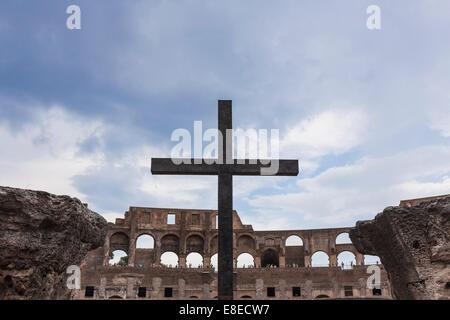 Cross in the Colosseum or Coliseum aka Flavian Amphitheatre (Anfiteatro Flavio, Colosseo), Rome, Italy - Stock Photo