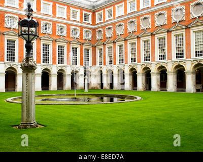 Fountain court at Hampton Court Palace - England - Stock Photo