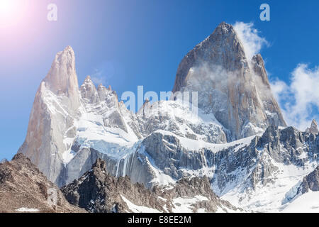 Sun over Fitz Roy Mountain, Patagonia in Argentina. - Stock Photo