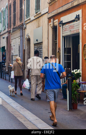 People walking in the streets of the Panier district of Marseille. - Stock Photo