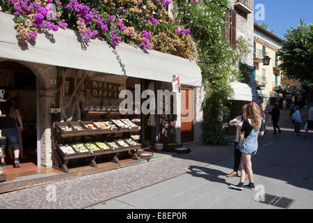 Food & Pasta store & Bougainvillea, Lake Garda ' Lago di Garda or Lago Benaco' lakeside, lake in Italy. A popular - Stock Photo