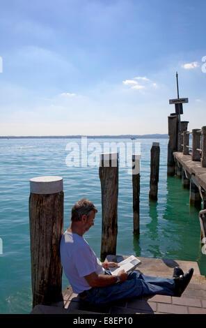 Lake Garda ' Lago di Garda or Lago Benaco' is the largest lake in Italy. A popular Italian holiday location, Europe, - Stock Photo