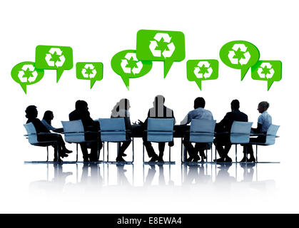 Silhouettes Of Business People In A Conference With Speech Bubbles Above Them With Recycling Symbols In Them. - Stock Photo