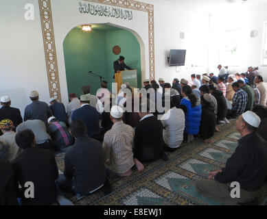 Believers are pictured at a Friday prayer in the Khadija mosque in Berlin, Germany, 03 October 2014. The Ahmadiyya - Stock Photo