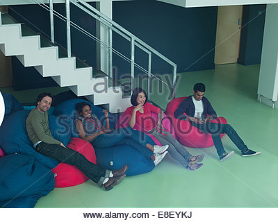 Business people in bean bag chairs - Stock Photo