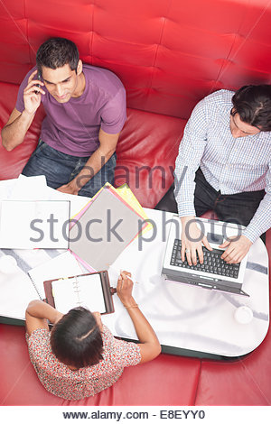 Smiling businessman talking on cell phone in meeting - Stock Photo