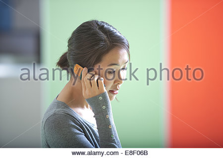 Woman talking on cell phone - Stock Photo