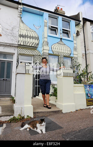 Brighton UK 3 October 2014 - Artist Kaye Teale  brightened up her house in Brighton by painting a mural of Royal - Stock Photo