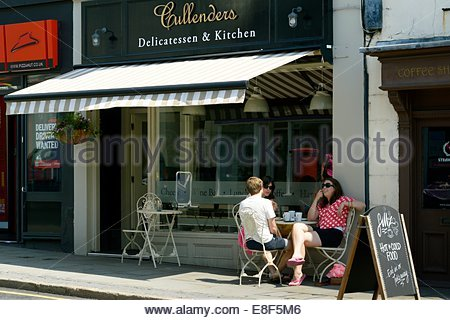 Customers sitting outside of Cullenders Cafe in the sunshine, Reigate, Surrey, England - Stock Photo