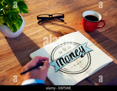Businessman Brainstorming About Money Matters - Stock Photo