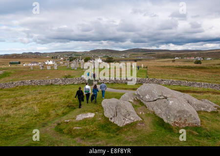 Visitors to the Callanish standing stones on the Isle of Lewis in the Outer Hebrides. - Stock Photo
