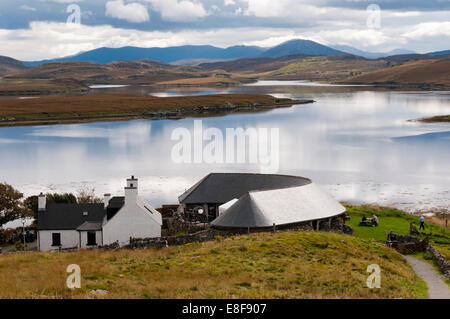 The Callanish Standing Stones Visitor Centre on the shores of Loch Ròg on the Isle of Lewis, Outer Hebrides. - Stock Photo