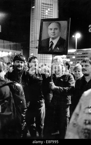During a Monday demonstration, demonstrators carry a photo of Soviet leader Mikhail Gorbachev in Leipzig on 23 October - Stock Photo
