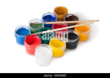 Jars With Gouache And Paint Brushes Isolated On White - Stock Photo