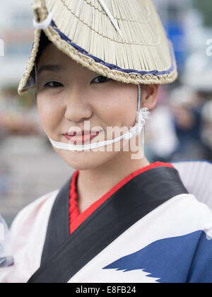 Woman in traditional straw hat at Awa Odori ( Awa Dance Festival ) held 12 to 15 August in Tokushima City on Shikoku, - Stock Photo