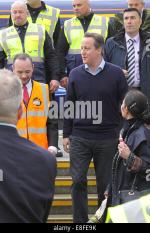 Prime Minister David Cameron visits Dawlish train station for the grand re-opening after the station was closed in February due to storm damage. Mr Cameron spoke to several members of public and rail staff, thanking all the workers on their hard efforts in getting the railway repaired in such a short period of time  Featuring: David Cameron Where: Dawlish, Devon, United Kingdom When: 04 Apr 2014