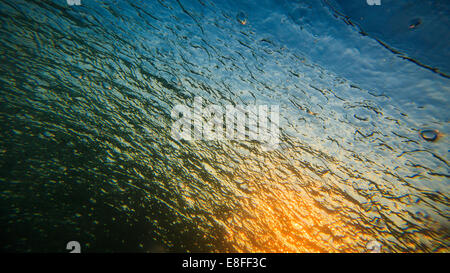 Close-up of sunrise reflected in Pacific Ocean - Stock Photo