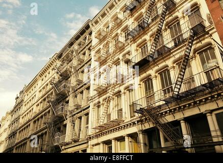 USA, New York State, New York City, Fire escapes on building - Stock Photo