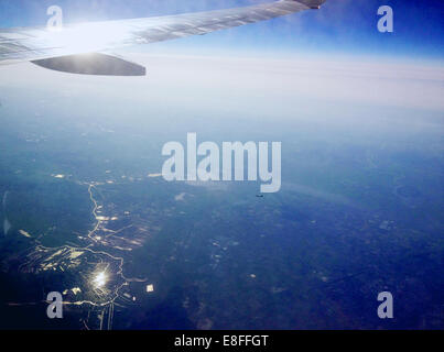 View of airplane wing from vehicle interior/airplane window - Stock Photo