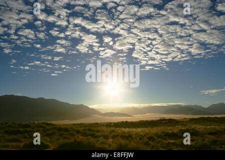 Desert and mountain landscape at sunset, namib-naukluft national park, Namibia - Stock Photo