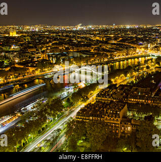 France, Paris, Aerial view of city at night - Stock Photo