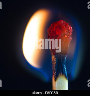 Close-up of a burning match - Stock Photo