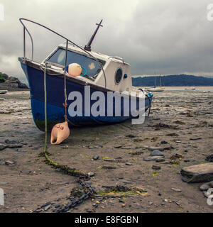Fishing Boat on beach at low tide - Stock Photo