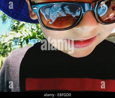 Portrait of a boy wearing sunglasses - Stock Photo