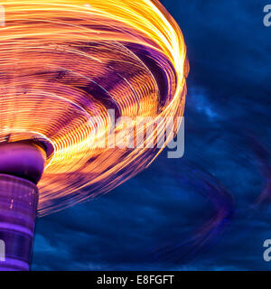 Blurred motion of carousel spinning - Stock Photo