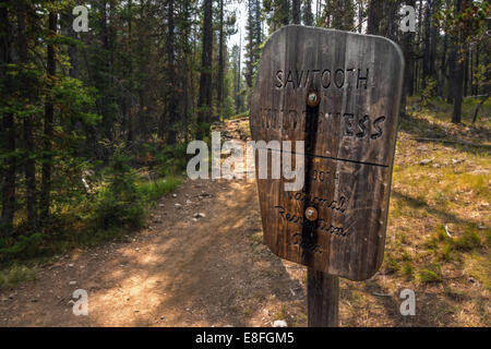 USA, Idaho, Custer County, Stanley, View of old wooden sign on hiking trail - Stock Photo