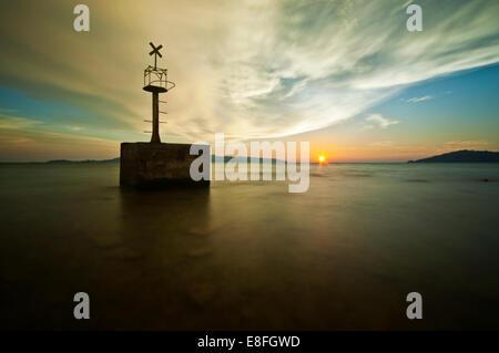 Malaysia, Sabah, Kota Kinabalu, Sunset over sea - Stock Photo