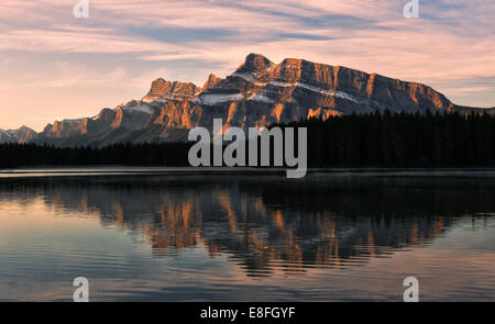 Mount Rudle reflected in Two Jack Lake, Banff National Park, Alberta, Canada - Stock Photo
