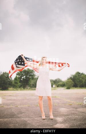 USA, Florida, Okaloosa County, Fort Walton Beach, Portrait of girl with american flag - Stock Photo