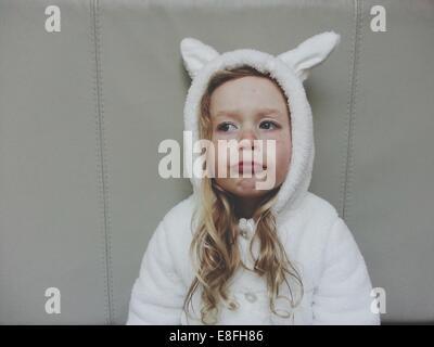 Girl in bunny rabbit costume - Stock Photo