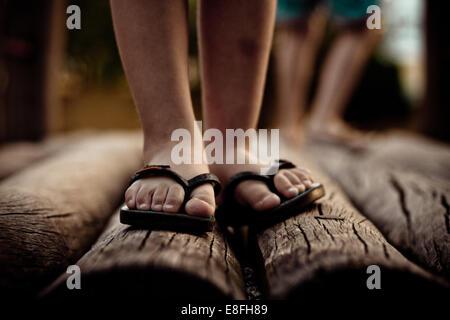 Close up of feet in flip flops