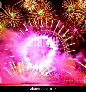 United Kingdom, London, London Eye fireworks - Stock Photo