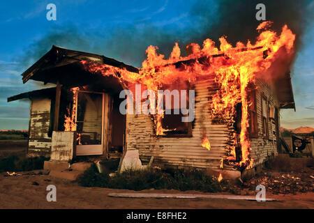 Abandoned house on fire, Gila Bend, Arizona, America, USA - Stock Photo