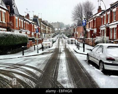 UK, London, London Borough of Haringey, Highgate Village, Urban street covered in snow - Stock Photo