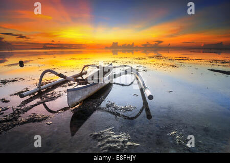 Indonesia, Bali, Boat on shallow during sunset - Stock Photo