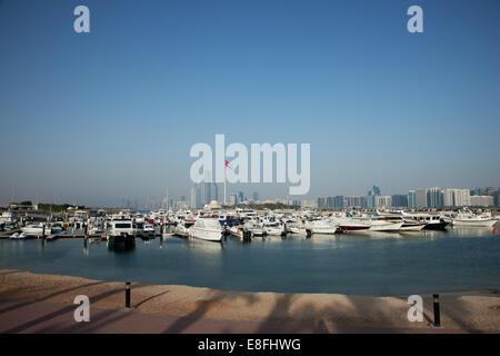 United Arab Emirates, Abu Dhabi, Skyline with harbor in foreground - Stock Photo