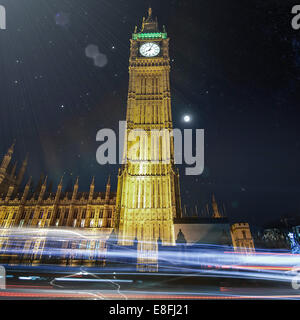 Big Ben at night with light trails, London, England, UK - Stock Photo